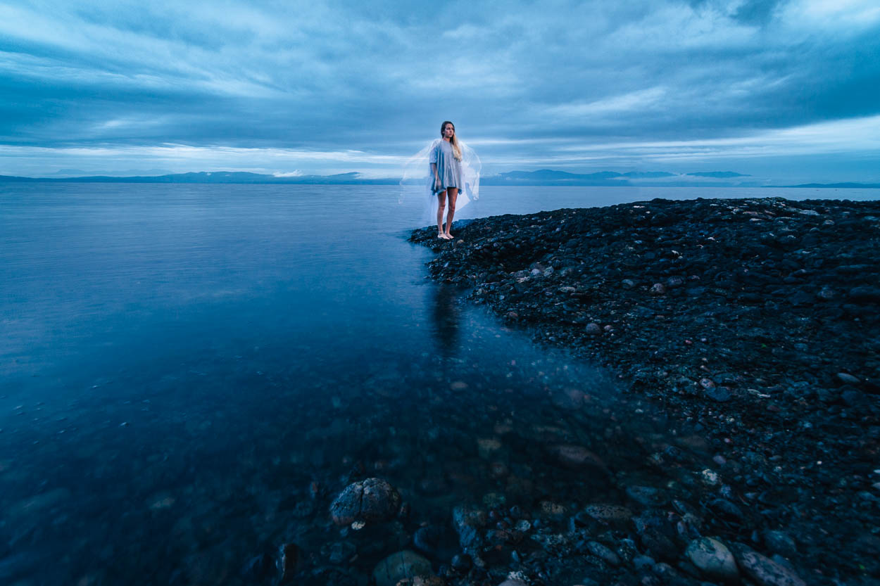 A young woman poses at the shore of Hornby Island