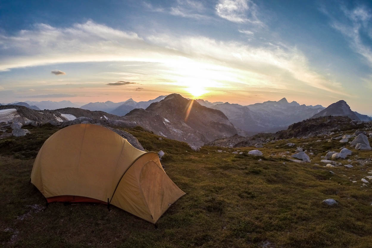 A tent sits on top of Mount Rohr, British Columbia at sunset