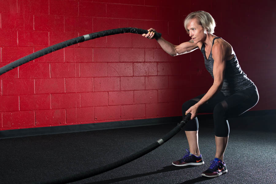 An athletic woman exercises at Kozoris Exceleration