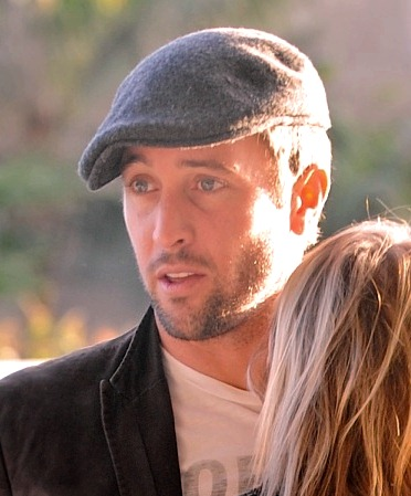 ©NATIONAL PHOTO GROUP Alex O'Loughlin kisses his girlfriend Amber Clayton goodbye at LAX Jan. 3rd, 2011