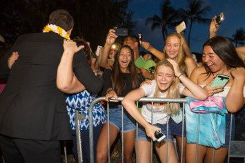 2016 SEPTEMBER 22 CTY - HSA Photo by Cindy Ellen Russell/crussell@staradvertiser.com Hawaii Five-O fans (l-r) Reiko Ramirez, Bryndall Macluney, Madeline Hicks and Maddie Matsumoto, all 18 years old, reacted as lead actor Alex O'Loughlin (left) approached them. The show held its season 7 premiere at Sunset on the Beach in Waikiki on Friday.