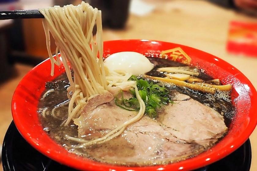 A bowl of black tonkotsu ramen from Hakata Gensuke