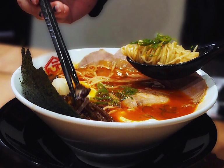A bowl of spicy god fire ramen from Hakata Gensuke