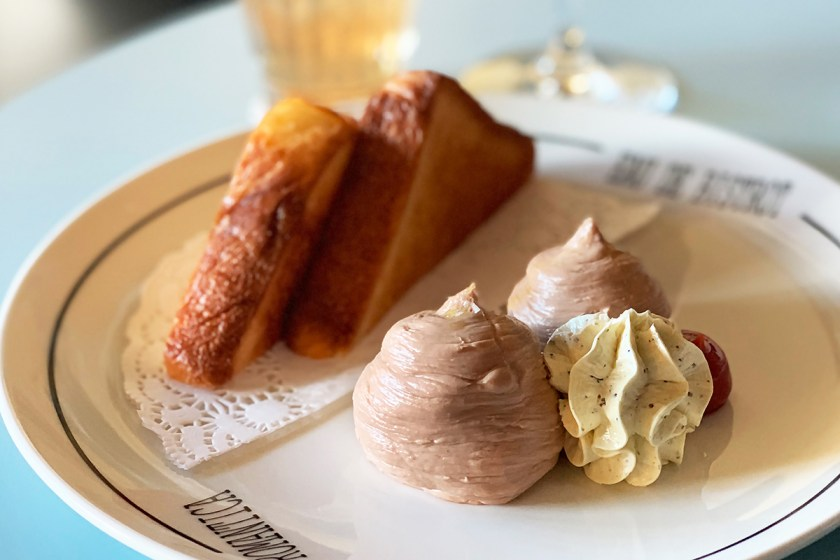 A plate of duck liver parfait served with toasted brioche and truffle butter from Le Rebelle
