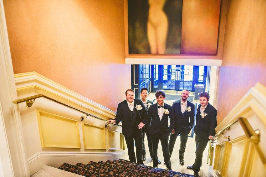Groom and groomsmen under nude portrait