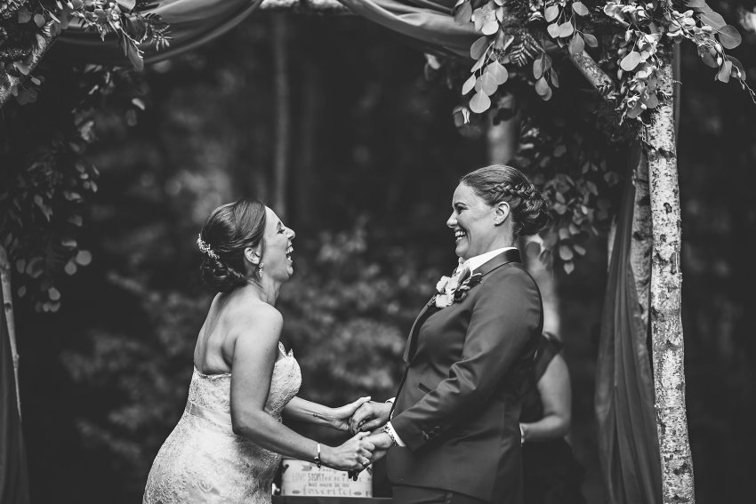 same sex couple laughing after ceremony