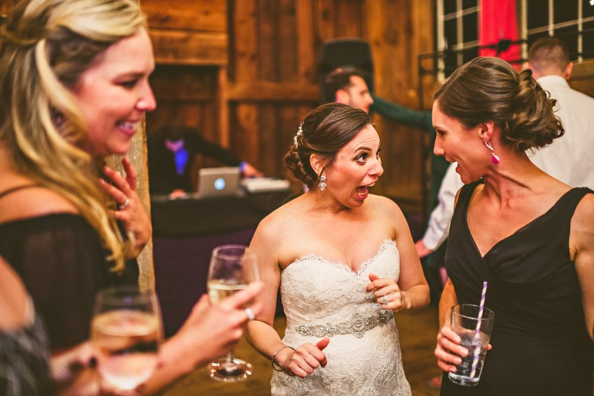 bride laughing with friends at reception