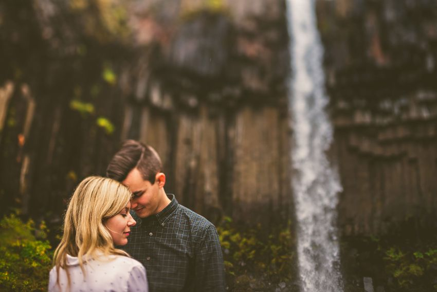 dreamy engagement portrait in front of Svartifoss