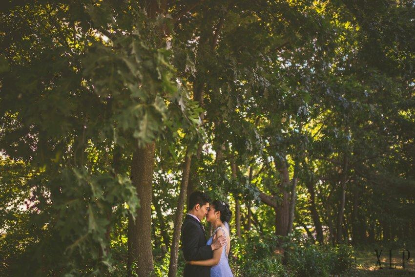 Wedding portrait by trees