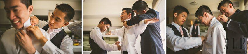 groomsmen helping groom