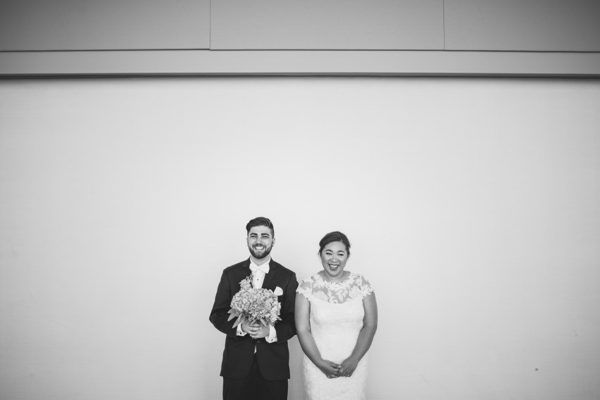 Bride and groom laughing in wedding portrait