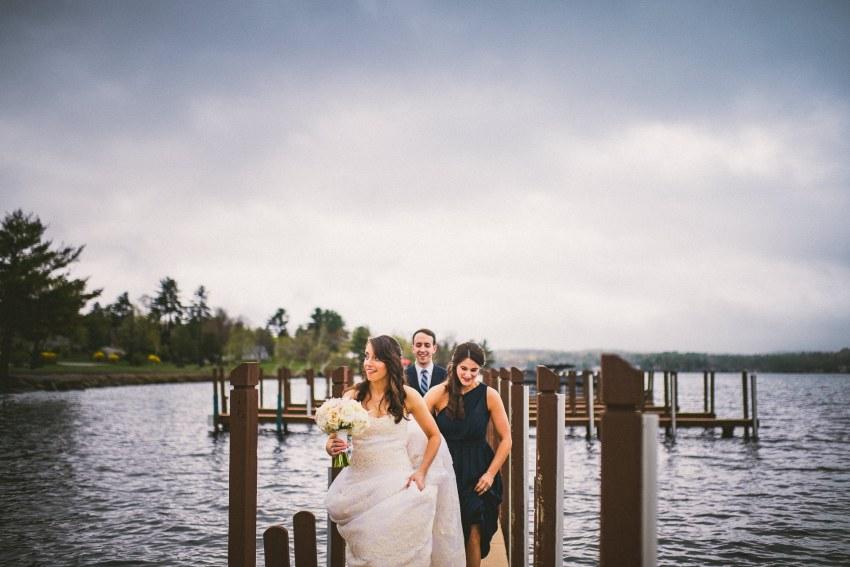 Bride and groom walking on dock