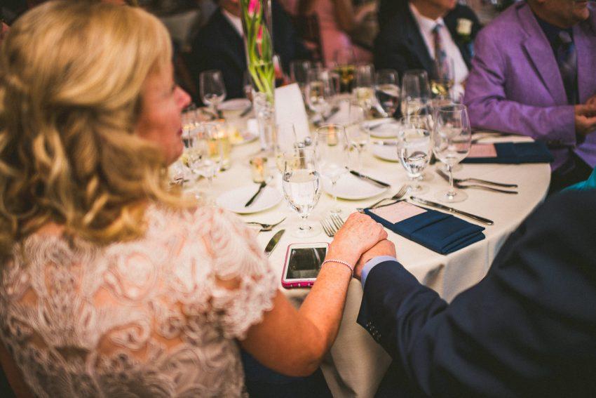 Bride parents holding hands