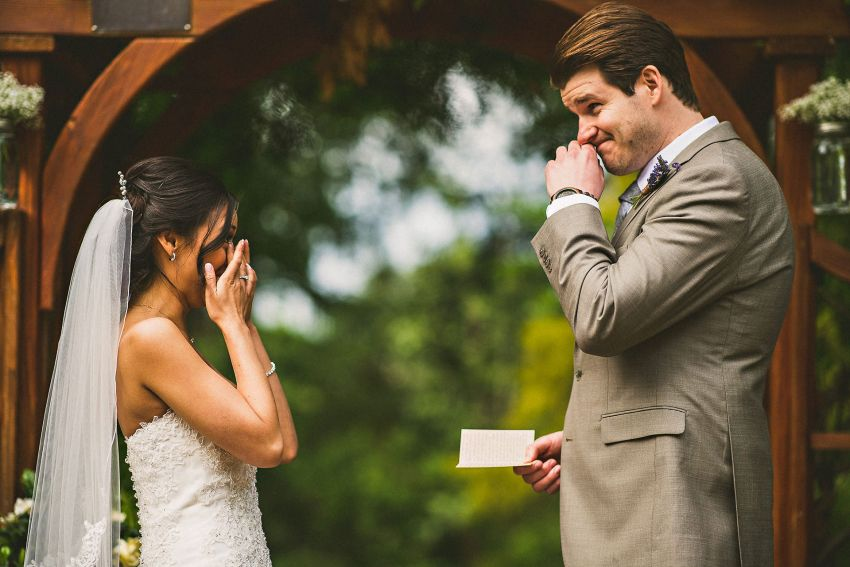 Bride and groom crying at Brooksby farm wedding ceremony
