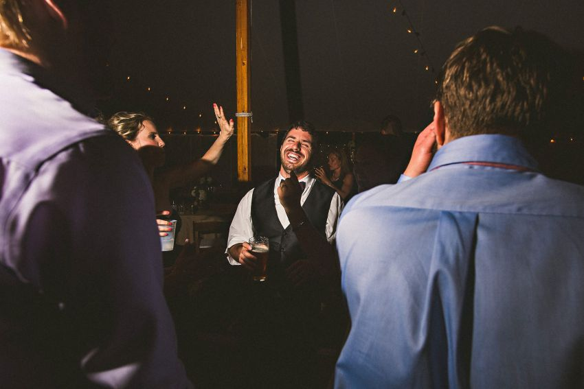 Groom laughing on dancefloor