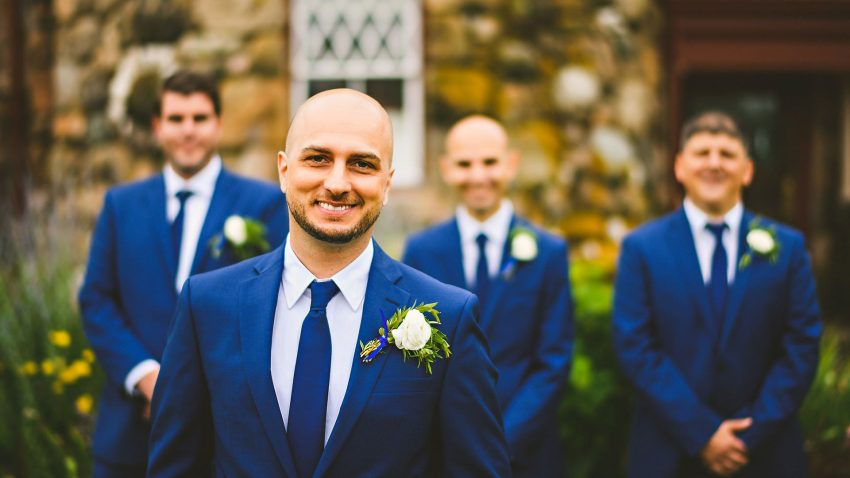 Groom smiling with groomsmen