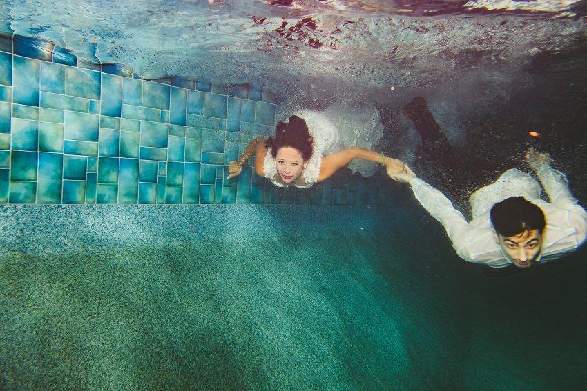 Rhode Island backyard wedding bride and groom swimming underwater