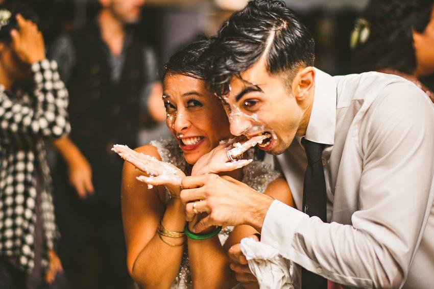 Messy Rhode Island wedding cake cutting