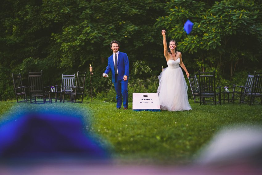 Bride and groom playing cornhole