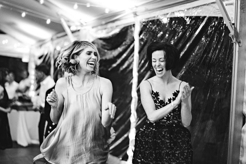 Maid of honor and friend dancing
