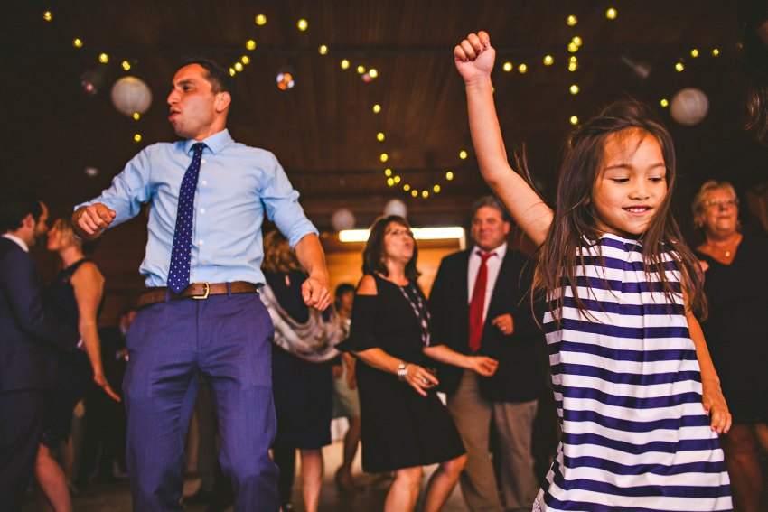 Flower girl dancing with brother of bride