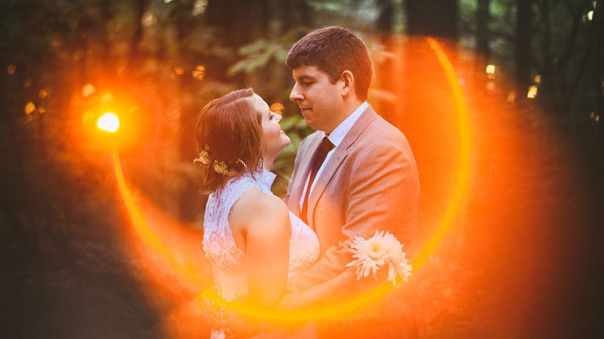 Lens flare wedding portrait