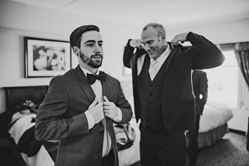 Groom and father getting dressed