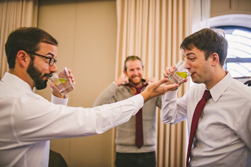 Groom drinking with groomsmen