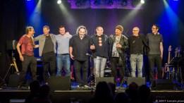 The Whole Enchilada v.l.n.r: Harry Lange (E-Git), Oliver Hahn (keys), Manni Müller (Drums/Percussion), Jerry Marotta (Drums/Vocals), Alex Sebastian (Vocals), Flav Martin (Acoustic Guitars, Vocals), Michele Vitulli (Chapman Stick, Bass), Markus Angeli (Bass)