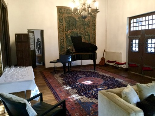 baby grand piano in chateau