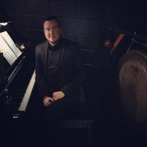 Alex at the piano and gong for A Day in Hollywood/A Night in the Ukraine in December 2014.