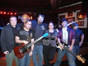 Shryne (L-R, Alex Tirrell, Anthony Mattera, Jon Brennan, Erin Boucher (manager), Andrew Sharp, Jeff Cruz) performed at the Hard Rock Cafe in Boston in May 2009. Photo by Kari Tieger.