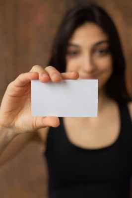 cheerful ethnic woman with blank business card