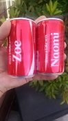 Stopped in to grab a bite, saw a booth that's doing customized Coke cans. Now I have a pair with my nieces' names. :)