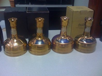 "All four Utopias...note that while all of the bottles are shaped like mash tuns, the '03, '05, and '07 releases have sliding ""doors"" on them. The '02 doesn't; the ""doors"" are fixed in the closed position."