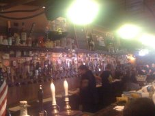 The wall o' beer taps, with some beer engines in the foreground (bottom left in the picture)