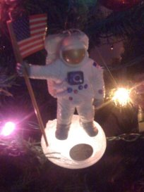 some non-fiction: Neil Armstrong on the moon. This ornament is from 1994, the 25th anniversary of Apollo 11. This year, of course, was the 40th anniversary.