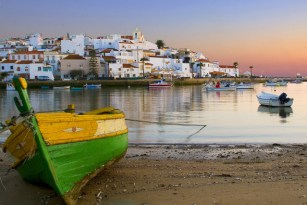 http---www.blogcdn.com-slideshows-images-slides-380-131-2-S3801312-slug-l-view-of-ferragudo-at-dusk-portugal-1
