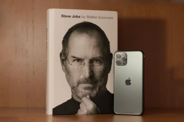 Steve Jobs biography next to iPhone