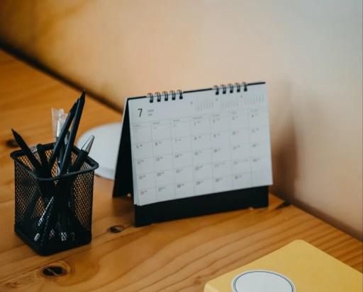 desk with paper calendar