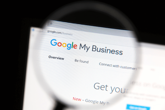 Google my business logo in magnifying glass