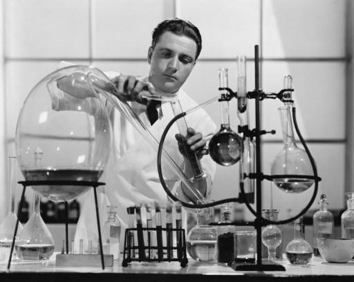 black & white scientist performing experiment