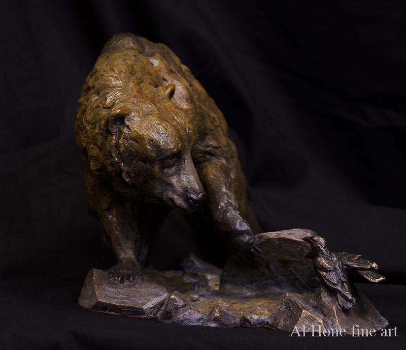 Bronze sculpture of bear and ravens