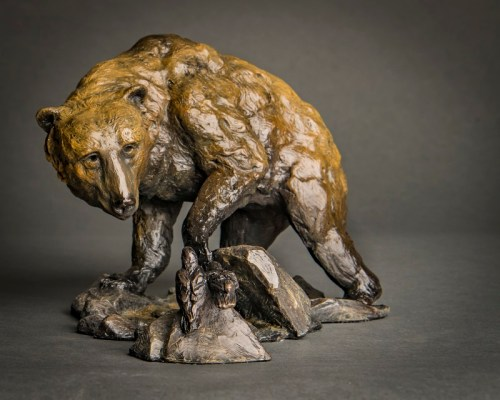 Grizzly bear and raven sculpture