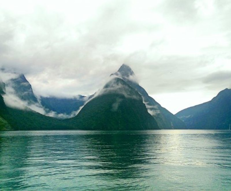 Mitre Peak at Milford Sound covered in mist.