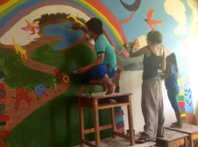 Freddy, Eileen, and Ruthi work on mural details.