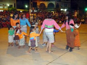Children dancing with their mothers at event