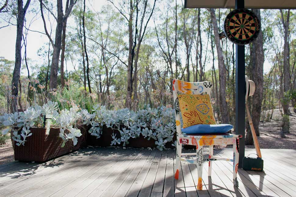 Sports equipment and an artist painted chair at Alice Barker House.