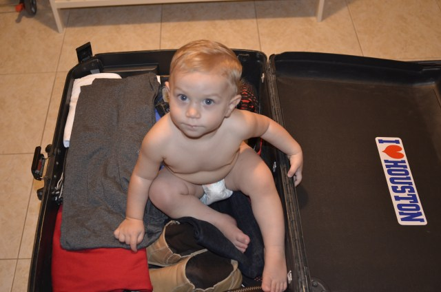 As Erroll prepared to pack and fly to Dallas, Kingsley packed himself n his dad's trunk