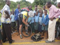 """Charles """"helping"""" with my puncture - my gratitude, amazement of crowd"""